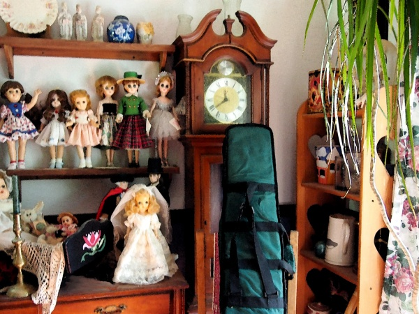 The dolls stand next to the clock is my sewing machine. Yes, it is still there.