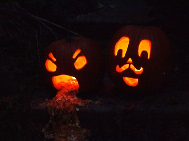 In the dark, glowing Jack O Lanterns