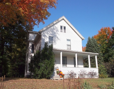 Farmhouse amidst maple trees