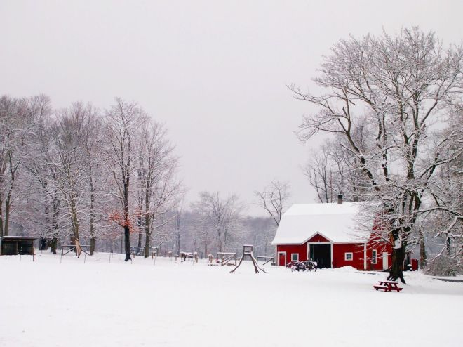 Red farmhouse in Snow