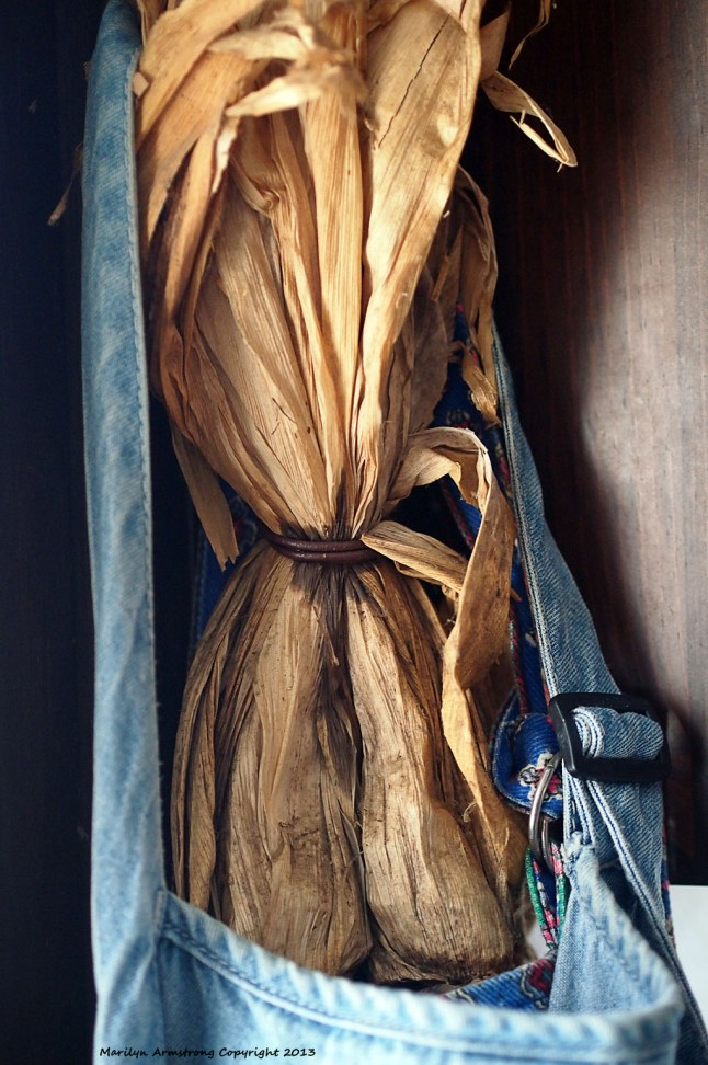 Corn husks and an old denim apron hang by the kitchen door.
