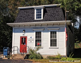 A stoop leading to the tiny post office in Manchaug