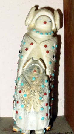 A carved antler double Corn Maiden