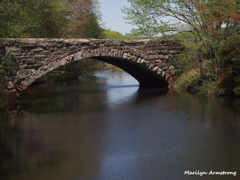 A stone bridge over the Blackstone River and Canal