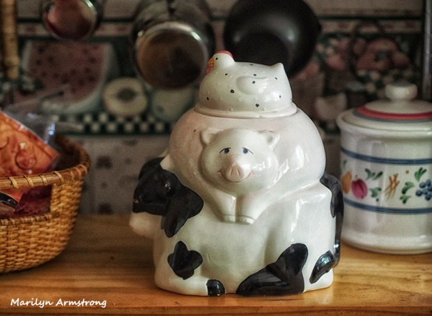The pig-chicken-cow antique canister where i store the Greenies