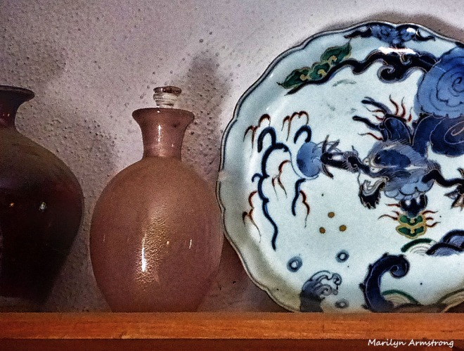 18th century Japanese porcelain cohabits with 19th century Italian blown glass.