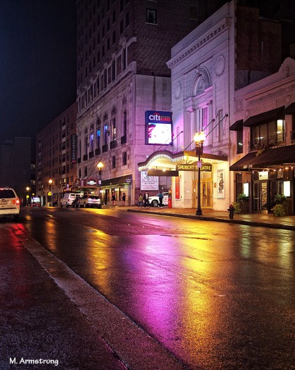 The glow of lights at night in Boston's theater district