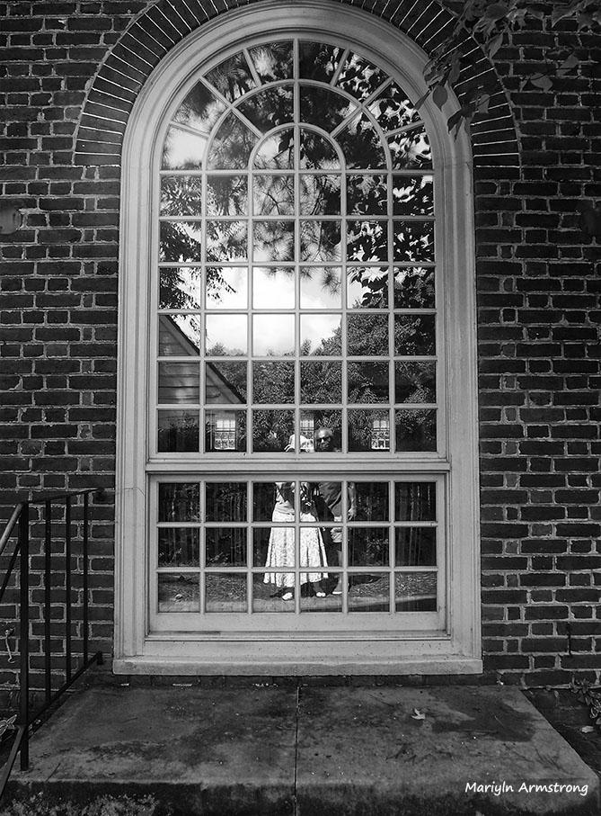 Reflection in williamsburg window  BW