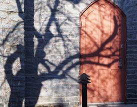 Shadow on a church door