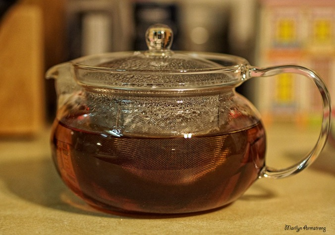 brewed tea in glass teapot