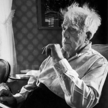 We own a signed print of this portrait of Robert Frost