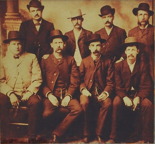 "The ""Dodge City Peace Commission"", June 1888. (L to R) standing: W.H. Harris, Luke Short, Bat Masterson, W.F. Petillon. Seated: Charlie Bassett, Wyatt Earp, Frank McLain and Neal Brown."