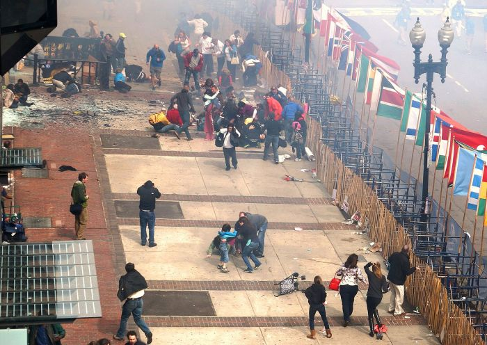 """1st Boston Marathon blast seen from 2nd floor and a half block away"" by Aaron Tang - http://www.flickr.com/photos/hahatango/8652829335/sizes/o/in/set-72157633252445135/. Licensed under CC BY 2.0 via Wikimedia Commons - http://commons.wikimedia.org/wiki/File:1st_Boston_Marathon_blast_seen_from_2nd_floor_and_a_half_block_away.jpg#/media/File:1st_Boston_Marathon_blast_seen_from_2nd_floor_and_a_half_block_away"