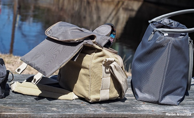 camera bags on park bench