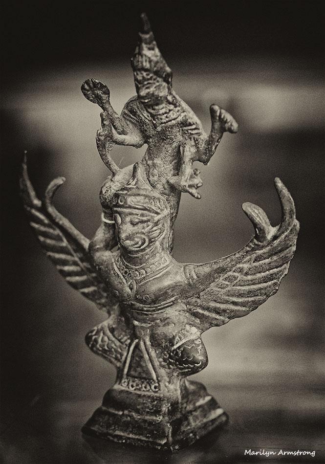 Vishnu rides garuda bronze macro sepia