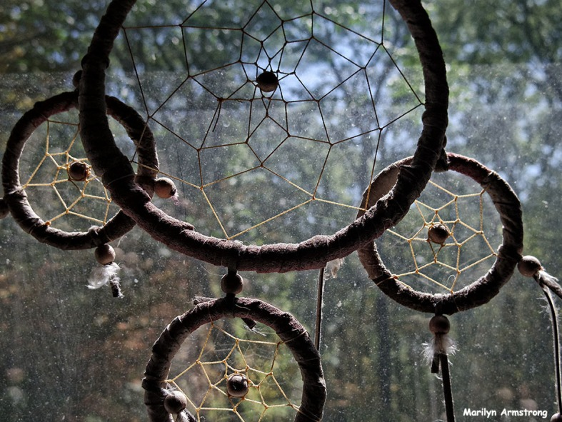 Brightly through the web of the dream catcher ...