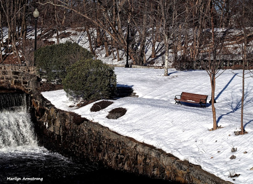 Snowy bench in March