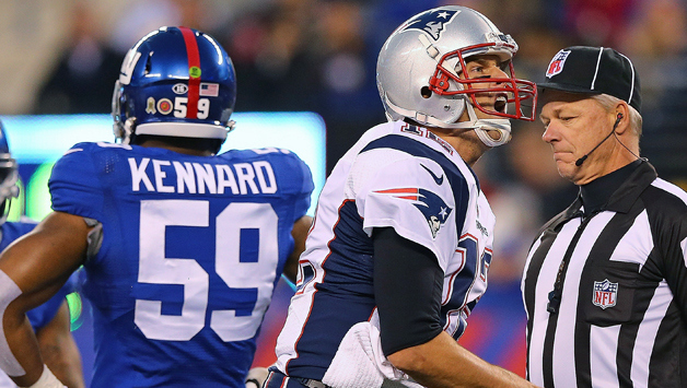 EAST RUTHERFORD, NJ - NOVEMBER 15: Tom Brady #12 of the New England Patriots celebrates a first down against the New York Giants during the first quarterat MetLife Stadium on November 15, 2015 in East Rutherford, New Jersey. (Photo by Elsa/Getty Images)