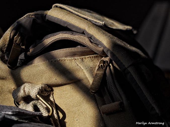 Afternoon sunlight on canvas camera bag