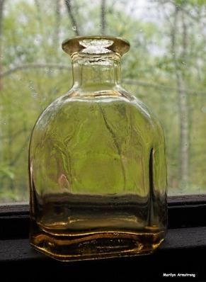 A very little gold bottle