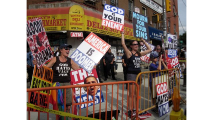 racist-signs-and-protesters