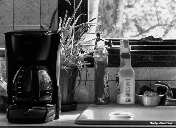 The coffee machine (though not the carafe), the bottles, the flower pot ... and the cup in the sink. Plastic.