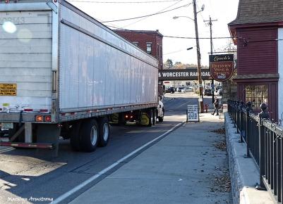 A big truck and a low bridge