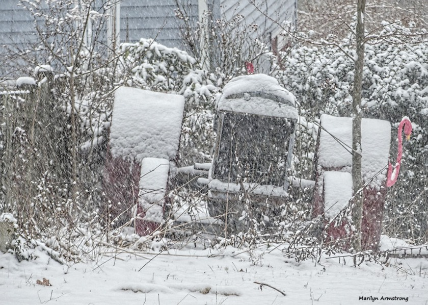 Outside, tractor in falling snow