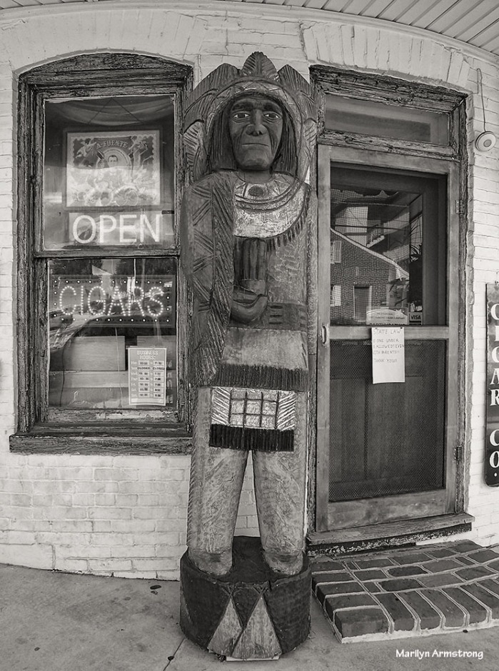 Magnificent life-size carving of a Native American man with tobacco