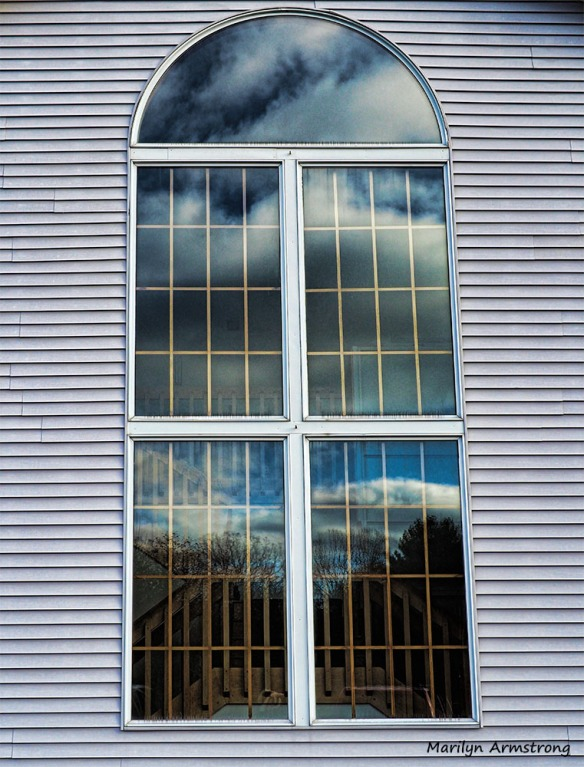 A graceful reflecting window in a modern building ... It doesn't have to be old to be elegant, balanced ... graceful