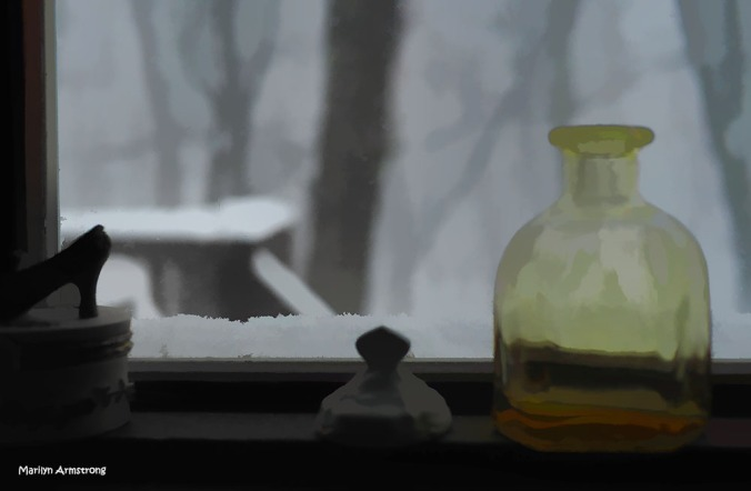 A shot of yellow glass against the monochrome landscape of snow.