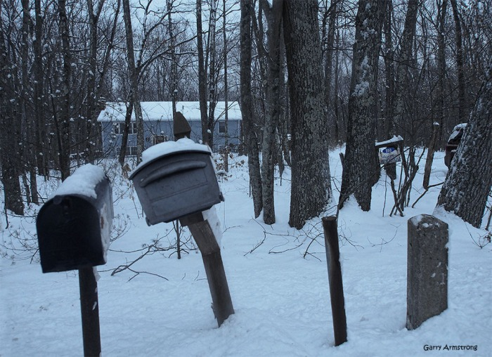 Only two mailboxes. There were three. Once was probably knocked down by the plow and is buried under the snow.