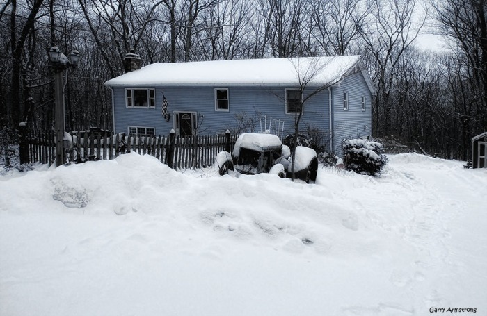 The old tractor and the house ... and the snow season has only just begun.