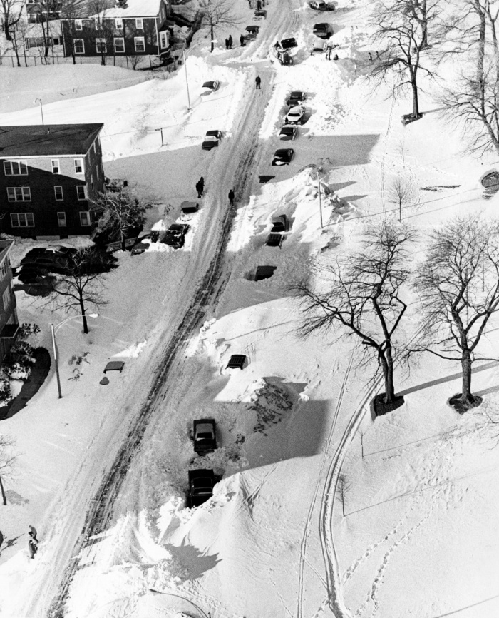 Seen from above, the daunting amount of snow residents had to dig through to get to their cars is apparent on Farragut Road in South Boston on Feb. 8, 1978. New England was hit by a blizzard with hurricane-force winds and record-breaking snowfalls the previous two days.