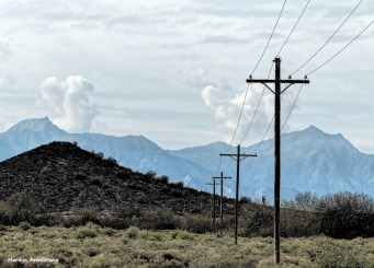 The wires run forever over the desert and into the mountains