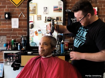 In the chair with the barber