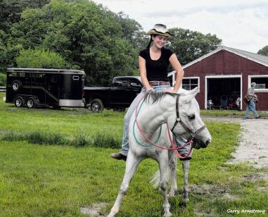 Hanging on on horseback