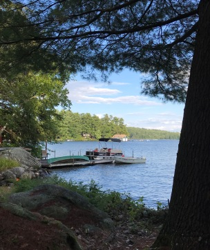 The dock and the lake through the trees