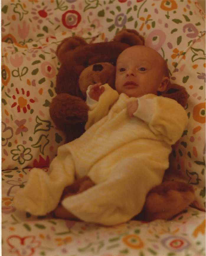 David being held by his Teddy Bear