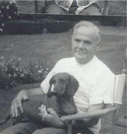 Grandpa and my dog, Schnitzel, who I got when I was eleven