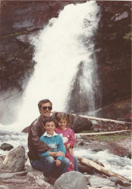 Larry and the kids at a waterfall in one of the national parks, 1989