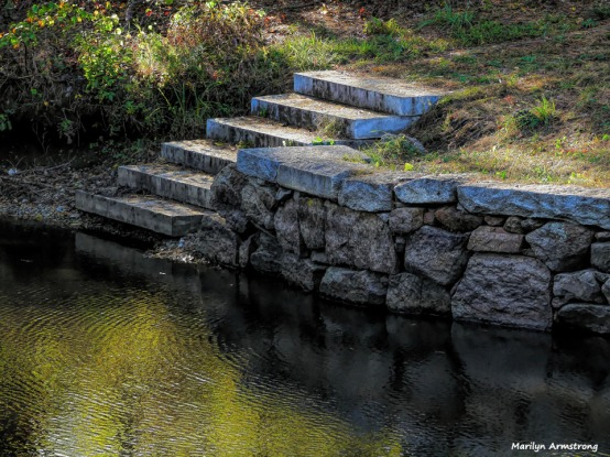 Stone steps lead down to the shiny canal