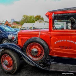 Red restored antique truck at Hannaford