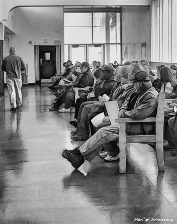 In the waiting chairs at the RMV