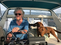 Captain Tom and his boat (Serenity) and dog - Photo: Ellin Curley