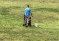 180-Man-dog-carriage-grass-Blackstone-River-Bend-Gar-090618_0130
