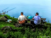 Photo: Garry Armstrong - Two guys fishing by the river