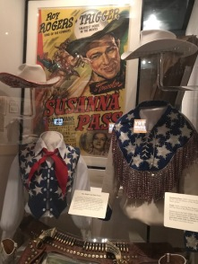 Roy Rogers poster and costumes from a movie