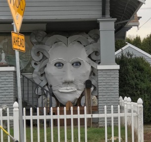 Interesting sculpture on house during the day