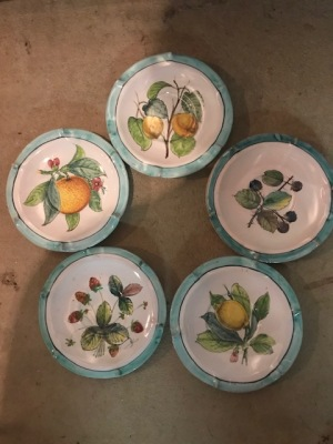 Tiny plates my mom used for decoration in a hutch